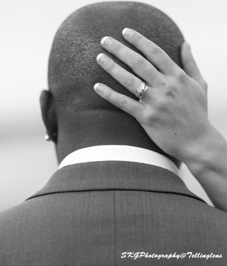Brides hand on Groom head